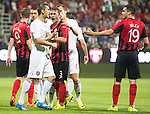 Spartak Trnava v St Johnstone...07.08.14  Europa League Qualifier 3rd Round<br /> Tam Scobbie squares up to Jose Casada<br /> Picture by Graeme Hart.<br /> Copyright Perthshire Picture Agency<br /> Tel: 01738 623350  Mobile: 07990 594431