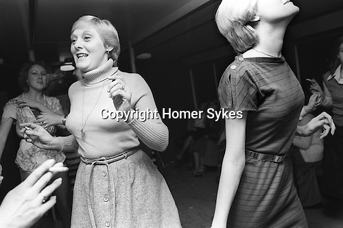 Hen Party 1970s London UK. Middle aged women dancing smoking together at a private womens only night hen do. England  70s 1979