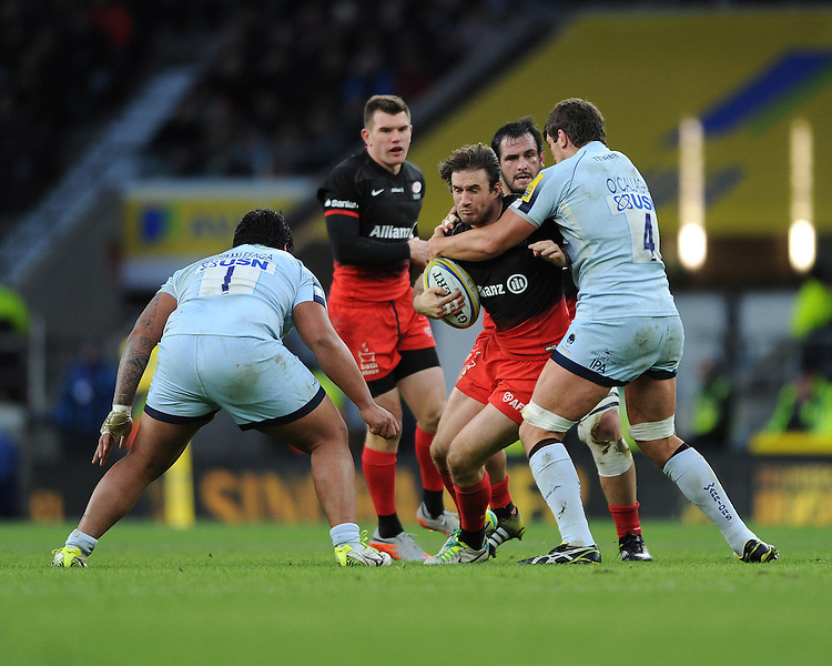 Marcelo Bosch of Saracens is tackled by Donncha O'Callaghan of Worcester Warriors during the Premiership Rugby match between Saracens and Worcester Warriors - 28/11/2015 - Twickenham Stadium, London<br /> Mandatory Credit: Rob Munro/Stewart Communications