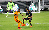 CARSON, CA - OCTOBER 28: Darwin Quintero #23 of the Houston Dynamo passes off the ball during a game between Houston Dynamo and Los Angeles FC at Banc of California Stadium on October 28, 2020 in Carson, California.