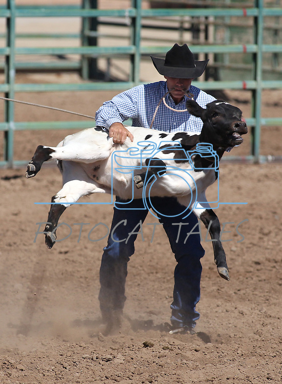 Jared McLenahan competes in the calf roping event at the Minden Ranch Rodeo on Sunday, July 24, 2011, in Gardnerville, Nev. .Photo by Cathleen Allison
