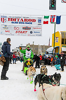 Ryan Redington and team leave the ceremonial start line with an Iditarider and handler at 4th Avenue and D street in downtown Anchorage, Alaska on Saturday March 7th during the 2020 Iditarod race. Photo copyright by Cathy Hart Photography.com