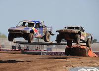 Apr 17, 2011; Surprise, AZ USA; LOORRS driver Ricky Johnson (48) leads Todd Leduc (4) during round 4 at Speedworld Off Road Park. Mandatory Credit: Mark J. Rebilas-