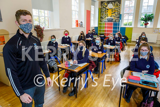 Kevin Moore in the classroom with returning students in Presentation Secondary School in Castleisland on Monday.