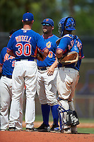 GCL Mets pitching coach Royce Ring (40) talks with pitcher Max Wotell (30) and catcher Ali Sanchez (3) during the first game of a doubleheader against the GCL Marlins on July 24, 2015 at the St. Lucie Sports Complex in St. Lucie, Florida.  GCL Marlins defeated the GCL Mets 5-4.  (Mike Janes/Four Seam Images)