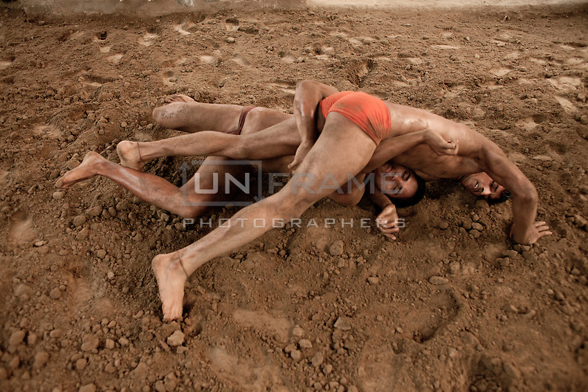 Two pehlwani (traditional Indian wrestlers) train in the Kolkata akhara (training hall for professional fighters)