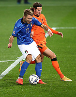 Football: Uefa Nations League Group A match Italy vs Netherlands at Gewiss stadium in Bergamo, on October 14, 2020.<br /> Italy's Ciro Immobile (l) in action with Netherlands' Hans Hateboer (l) during the Uefa Nations League match between Italy and Netherlands at Gewiss stadium in Bergamo, on October 14, 2020. <br /> UPDATE IMAGES PRESS/Isabella Bonotto