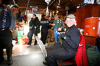 Wednesday March 7, 2007   ----  Race Judge Rhodi Korella takes a break with other volunteers at the Ophir checkpoint cabin of Dick and Audra Forsgren