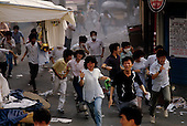 """Seoul, South Korea<br /> June 26, 1987<br /> <br /> The streets of Seoul filled with tear gas.<br /> <br /> After two decades of building an economic miracle, in the summer of 1987 tens of thousands of frustrated South Korean students took to the streets demanding democratic reform. """"People Power"""" Korean-style saw Koreans from all social spectrums join in the protests.<br /> <br /> With the Olympics to be held in South Korea in 1988, President Chun Doo Hwan decided on no political reforms and to choose the ruling party chairman, Roh Tae Woo, as his heir. The protests multiplied and after 3 weeks Chun conceded releasing oppositionist Kim Dae Jung from his 55th house arrest and shaking hands with opposition leader Kim Young Sam. Days later he endorsed presidential elections and an amnesty for nearly 3,000 political prisoners. It marked the first genuine initiative of democratic reform in South Korea and the people had their victory."""