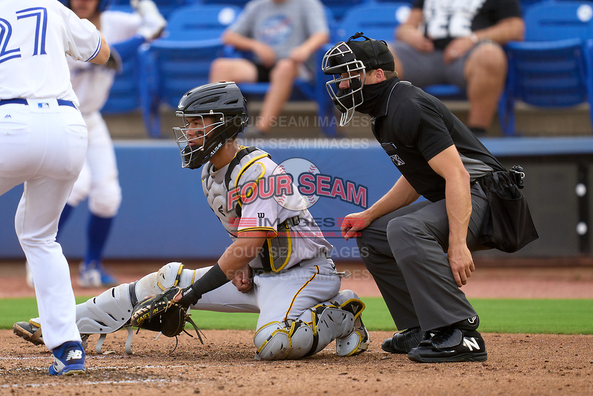 Umpire Casey James and Bradenton Marauders catcher Endy Rodriguez (5) during a game against the Dunedin Blue Jays on June 5, 2021 at TD Ballpark in Dunedin, Florida.  (Mike Janes/Four Seam Images)