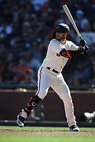 SAN FRANCISCO, CA - SEPTEMBER 19:  Tommy La Stella #18 of the San Francisco Giants bats against the Atlanta Braves during the game at Oracle Park on Sunday, September 19, 2021 in San Francisco, California. (Photo by Brad Mangin)