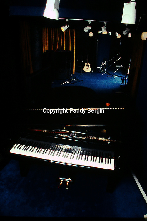 Yamaha Mini Grand Piano at Pebble Beach Sound Recorders, a 24 Track studio in Worthing, West Sussex. The Helios desk came from Ramport Studios which was a South London recording studio on Thessaly Road and was owned by The Who.<br /> <br /> Pebble Beach opened in the mid 70s and was owned by Adam Sieff, Andy Cowan Martin was the MD, Robin Greatrex did PR, I was the Studio Manager and Tony Platt was the Sound Engineer.<br /> <br /> Stock Photo by Paddy Bergin