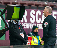9th January 2021; Turf Moor, Burnley, Lanchashire, England; English FA Cup Football, Burnley versus Milton Keynes Dons; Referee Jonathan Moss reviews the action on the VAR screen before ruling out the red card to Richard Keogh of MK Dons