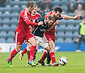 Dundee's Martin Boyle tries to get past Aberdeen's Niall McGinn and Andrew Considine.