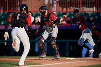 Altoona Curve catcher Arden Pabst (53) waits for a throw as Sergio Alcantara (1) runs home with pitcher James Marvel (29) backing up the play during an Eastern League game against the Erie SeaWolves on June 3, 2019 at UPMC Park in Erie, Pennsylvania.  Altoona defeated Erie 9-8.  (Mike Janes/Four Seam Images)