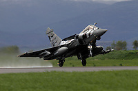 A French Rafale fighter jet with tiger paint scheme takes off. Nato Tiger Meet is an annual gathering of squadrons using the tiger as their mascot. While originally mostly a social event it is now a full military exercise. Tiger Meet 2012 was held at the Norwegian air base Ørlandet.