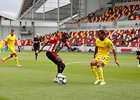 6th September 2020; Brentford Community Stadium, London, England; English Football League Cup, Carabao Cup, Football, Brentford FC versus Wycombe Wanderers; Tariqe Fosu of Brentford being marked by Darius Charles of Wycombe Wanderers