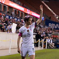 Megan Rapinoe #15 of the United States signals for a corner kick