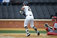 Jake Mueller (23) of the Wake Forest Demon Deacons squares to bunt against the Sacred Heart Pioneers at David F. Couch Ballpark on February 15, 2019 in  Winston-Salem, North Carolina.  The Demon Deacons defeated the Pioneers 14-1. (Brian Westerholt/Four Seam Images)