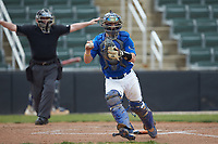 Mars Hill Lions catcher Austin Purser (37) prepares to make a throw to first base after a dropped third strike as home plate umpire Grant Akins makes a safe sign during the game against the Queens Royals at Intimidators Stadium on March 30, 2019 in Kannapolis, North Carolina. The Royals defeated the Bulldogs 11-6 in game one of a double-header. (Brian Westerholt/Four Seam Images)