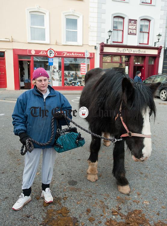 Joan Henchy of Kilkee with her horse at Kilrush Horse Fair on Monday. Photograph by John Kelly.