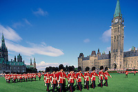 Changing of the Guard Ceremony at the Parliament Buildings on Parliament Hill, Ottawa, Ontario, Canada- West Block built 1865) and Centre Block with Peace Tower (built 1865 - 1927)