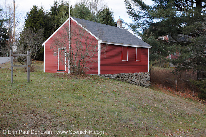 The Little Red Schoolhouse during the autumn months. Located in Newport, New Hampshire USA  which is part of New England. This schoolhouse is listed on the National Register of Historic Places.
