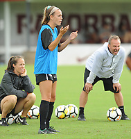 NWA Democrat-Gazette/ANDY SHUPE<br /> Arkansas junior Reid Sibley (center) and coach Colby Hale watch Wednesday, Aug. 16, 2017, during practice at Razorback Field in Fayetteville. The Razorbacks enter the season ranked 17th and are coming off a year they finished No. 19, made the SEC tournament finals and won a match in the NCAA Tournament.