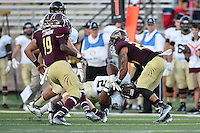 Idaho running back Kristoffer Olugbode (21) is brought down by Texas State cornerback David Mims II (22) during first half of an NCAA Football game, Saturday, October 04, 2014 in San Marcos, Tex. Texas State leads Idaho 21-3 at the halftime(Mo Khursheed/TFV Media via AP Images)