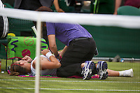 27-06-13, England, London,  AELTC, Wimbledon, Tennis, Wimbledon 2013, Day four, Simona Halep (ROU) gets a medicate treatment<br /> <br /> <br /> <br /> Photo: Henk Koster