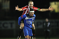 Elliot Styles of Hornchurch takes a ride on the back of Ryan Salmon of Aveley - AFC Hornchurch vs Aveley - Ryman League Premier Division Football at The Stadium - 08/03/11 - MANDATORY CREDIT: Gavin Ellis/TGSPHOTO - Self billing applies where appropriate - Tel: 0845 094 6026