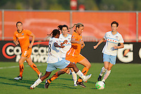 Laura Kalmari (21) of Sky Blue FC looks to get past a trio of Chicago Red Stars. The Chicago Red Stars defeated Sky Blue FC 2-1 during a Women's Professional Soccer (WPS) match at Yurcak Field in Piscataway, NJ, on August 01, 2010.