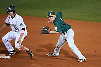 Siena Saints shortstop Tyler Martis (1) looks to throw to first base as Jacob Koos (1) slides in during a game against the Stetson Hatters on February 23, 2016 at Melching Field at Conrad Park in DeLand, Florida.  Stetson defeated Siena 5-3.  (Mike Janes/Four Seam Images)