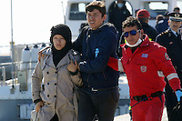 Pictured: A young couple are helped to safety by a member of the emergency services Thursday 27 November 2014<br />