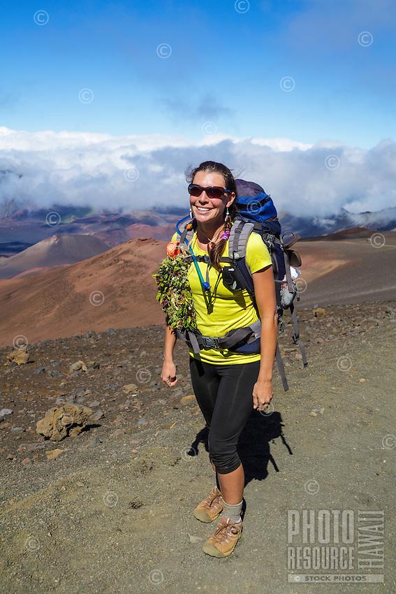 A backpacker on the Sliding Sands Trail at Haleakala National Park, Maui.