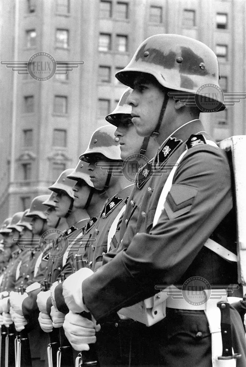 A parade of soldiers in the city centre.