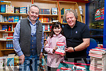 Cahersiveen born School Teacher, Radio Presenter and now a Children's Book Writer Peter Grogan pictured here on the right with young book reviewer Layla O'Donoghue from Portmagee and Colman Quirke at the book signing of Seamróg on Tuesday at Quirkes Newsagents in Cahersiveen.