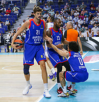 30th September 2021; Madrid, Spain:  Euroleague Basketball, Real Madrid versus Anadolu Efes Istanbul;  Shane Larkin is helped up by James Anderson and Tibor Pleiss of team Anadolu Efes during the Matchday 1 between Real Madrid and Anadolu Efes Istanbul