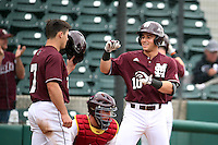 Ryan Gridley (10) of the Mississippi State Bulldogs is greeted by teammate Jacob Robson (7) after scoring during a game against the Southern California Trojans at Dedeaux Field on March 5, 2016 in Los Angeles, California. Mississippi State defeated Southern California , 8-7. (Larry Goren/Four Seam Images)