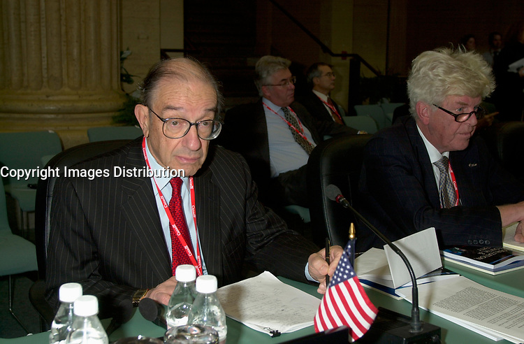 OTTAWA , November 17th 2001 FILE PHOTO<br /> <br /> US Federal Reserve System, Board of Governors' Chairman  Alan Greenspan  look at photographers  while US Secretary of the Treasury ;  Paul Heny O'Neill (R) and other G-20's Finances Ministers and Central Bank Governors get ready for the first meeting of Summit  2nd  day. November 17th, 2001 in Ottawa, CANADA<br /> <br /> The  G-20 meeting , where central bank chiefs and finance ministers from rich and poor nations discuss topics such as ; terrorism funding, economy slowdown and 3rd world nation's debt was initially scheduled for september in India,but  postponed  to  November 16th to 18th, 2001 and is beeing hosted by G-20 Chair ;  Canada Minister of Finance ;  Paul Martin.<br /> <br /> (Photo by Pierre Roussel /I Photo)<br /> ON SPEC<br /> NOTE l Nikon D-1 jpeg opened with quimage icc profile, saved in Adobe 1998 RGB.