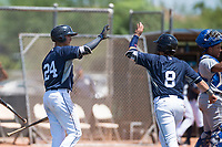 AZL Padres 1 right fielder Agustin Ruiz (24) high fives Rainier Aguilar (8) in front of catcher Stephan Vidal (13) during an Arizona League game against the AZL Royals at Peoria Sports Complex on July 4, 2018 in Peoria, Arizona. The AZL Royals defeated the AZL Padres 1 5-4. (Zachary Lucy/Four Seam Images)