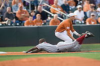 Stanford 1B Brian Ragira slides headfirst following a triple against Texas on March 4th, 2011 at UFCU Disch-Falk Field in Austin, Texas.  (Photo by Andrew Woolley / Four Seam Images)