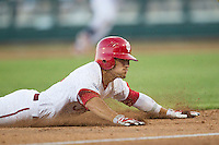 Indiana Hoosiers outfielder Wil Nolden (11) slides head first into third base against the Mississippi State Bulldogs during Game 6 of the 2013 Men's College World Series on June 17, 2013 at TD Ameritrade Park in Omaha, Nebraska. The Bulldogs defeated Hoosiers 5-4. (Andrew Woolley/Four Seam Images)
