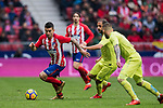 Angel Correa (L) of Atletico de Madrid is tackled by players of Getafe CF during the La Liga 2017-18 match between Atletico de Madrid and Getafe CF at Wanda Metropolitano on January 06 2018 in Madrid, Spain. Photo by Diego Gonzalez / Power Sport Images
