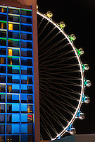 Las Vegas, Nevada.  Gondolas at Night on the High Roller, the highest observation wheel in the world as of 2015.  The Linq Hotel in foreground left.