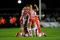 Gloucester Rugby celebrate with team mates at the final whistle