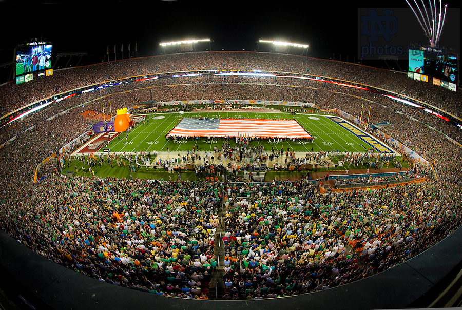 Jan. 7, 2013; The American flag is unfurled before kick off of the 2013 BCS National Championship against Notre Dame and Alabama in Miami, Florida. Photo by Barbara Johnston/University of Notre Dame