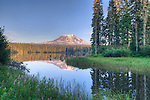 Mt. Adams, a stratovolcano towering over 12,000 feet in the Cascade Mountain Range of Washington State, USA, is reflected in Lake Takhlakh, in the Gifford Pinchot National Forest.  Mt. Adams is located just 31 miles east of Mt. St. Helens.