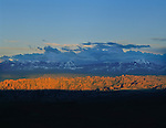 Sun light up slickrock formations, from Island in the Sky area, Canyonlands National Park, Moab, Utah, USA.