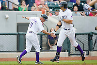 Winston-Salem Dash manager Joe McEwing #11 slaps hands with Seth Loman #24 following a home run against the Lynchburg Hillcats at  BB&T Ballpark May 22, 2010, in Winston-Salem, North Carolina.  Photo by Brian Westerholt / Four Seam Images